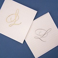 Masslinn white cocktail napkins printed with 75-S single monogram initial in Antique Satin and Platinum Satin imprint colors