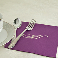 6 x 6 Purple personalized disposable linen like luncheon napkin next to coffee cup and saucer