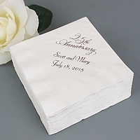 White cocktail napkins printed with Metallic Silver imprint color, VW25 anniversary design, and two lines of text in Florentine Cursive lettering style