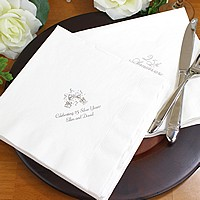 White dinner napkins printed with Metallic Silver imprint color, anniversary design, and two lines of text
