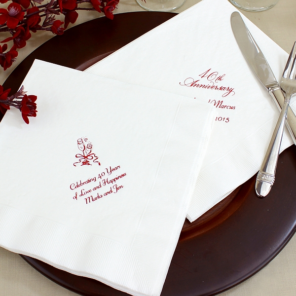 White dinner napkins printed with Metallic Red imprint color, anniversary designs, and custom text
