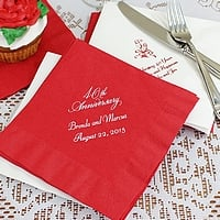 Red and white anniversary luncheon napkins printed with anniversary designs and lines of custom print