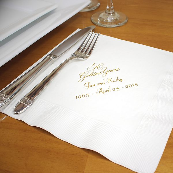 White dinner napkins printed with Antique Satin imprint color, VWGY anniversary design, and two lines of text in Florentine Cursive lettering style