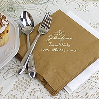 Gold anniversary luncheon napkins printed with ivory matte imprint color, VWGY anniversary design, and two lines of text in Florentine Cursive lettering style