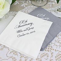White and silver anniversary cocktail napkins printed with napkin Placement A, VW60 anniversary design, and two lines of text in Florentine Cursive lettering style