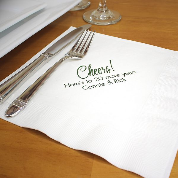 White dinner napkins printed with Emerald Satin imprint color, PC3 anniversary design, and two lines of text in Tempo lettering style