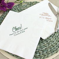 White dinner napkins printed with anniversary designs and two lines of custom text