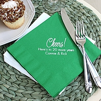 Green anniversary luncheon napkins printed with Platinum Satin imprint color, PC3 anniversary design, and two lines of text in Tempo lettering style