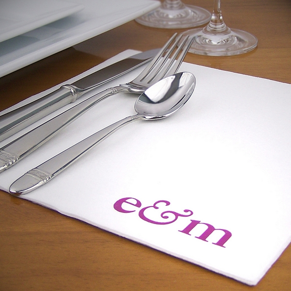 White fine linen disposable dinner napkin printed with Fuchsia Satin imprint color, napkin placement G, and one line of text in Caslon lettering style