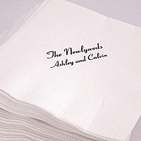 White personalized economy cocktail napkins printed with black imprint color and two lines of text in Coronet lettering style