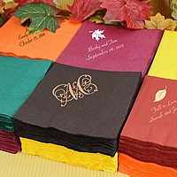 Assorted personalized cocktail napkins with fall themed designs and monogram
