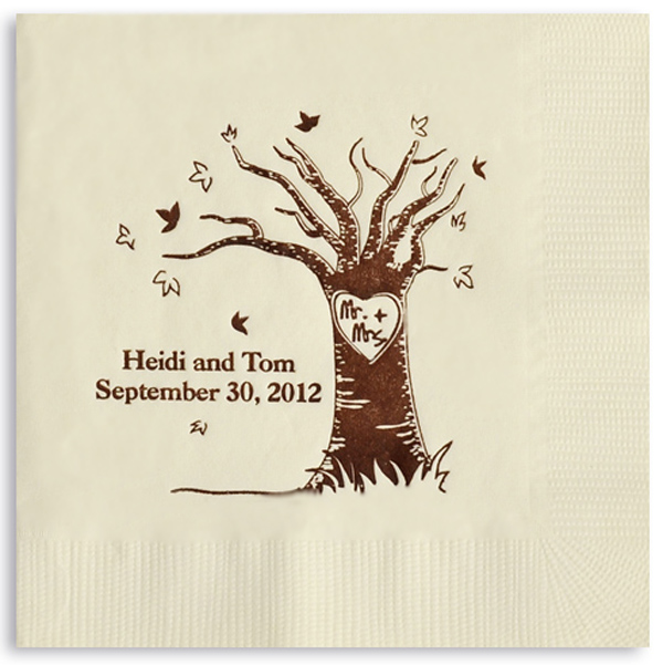 Warm white cocktail napkin printed with the Mr. + Mrs. love tree design personalized with 2 lines of custom text in brown imprint