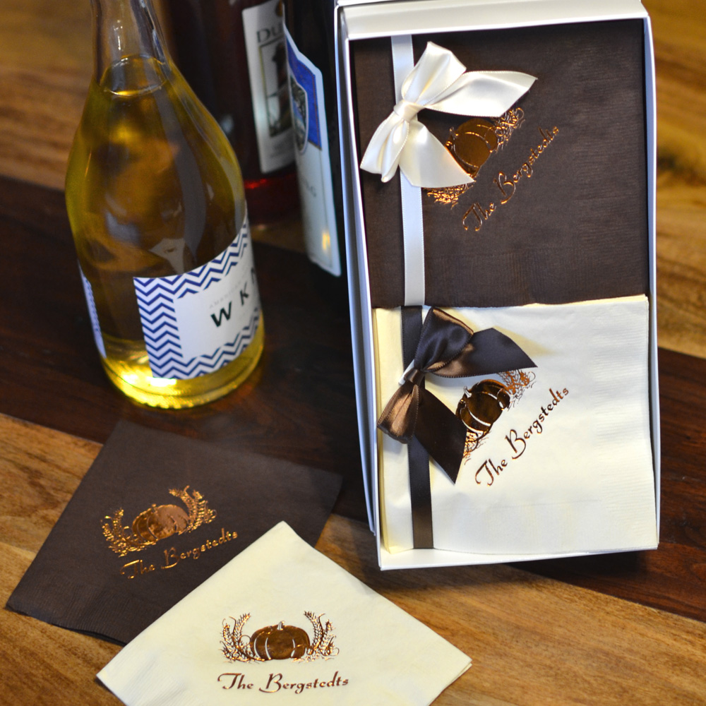 Personalized 100 Cocktail Napkin Boxed Gift Set shown with Chocolate and Ivory napkins, Metallic Copper imprint, F0003 design and one line of text in Coronet lettering style
