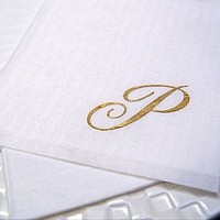 Premium masslinn monogrammed cocktail napkin printed with Quill single monogram in Gold