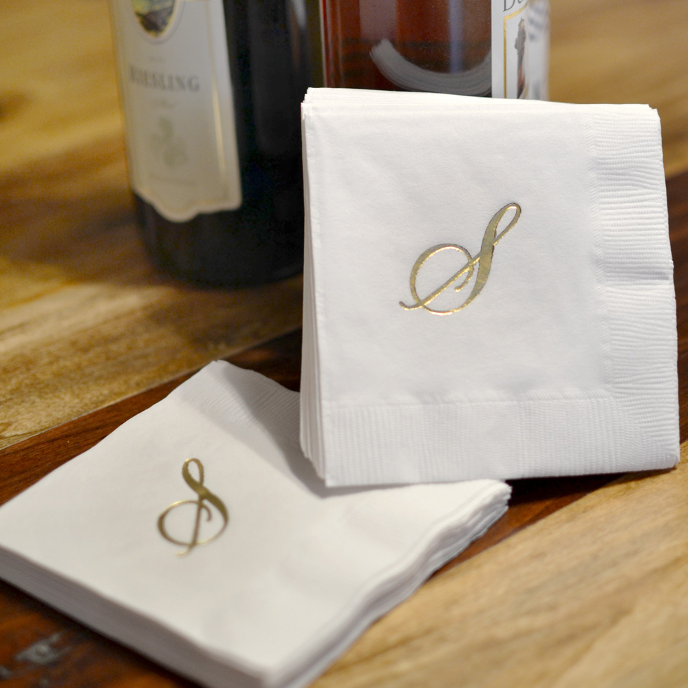 Monogrammed white 3-ply napkin gift set printed with Quill single monogram initial in Gold print color