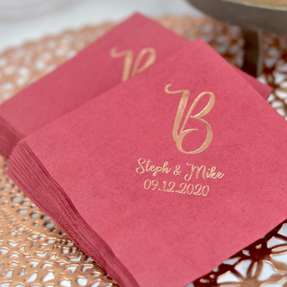 3-Ply Luncheon Napkins in Burgundy with Metallic Copper Imprint, a single initial and two lines of text