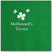 Green cocktail napkin printed with IR1100 shamrock design, Americana letter style, White imprint color and Center Horizontal print placement
