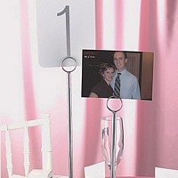 12 inch stand holding photo and 15 inch stand holding table number card