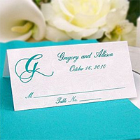 Personalized White Riccio tent style place card printed with Teal Standard Ink, 35-S single monogram initial, and 4 lines of print in Formal Script lettering style