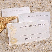 Choose Your Color Sanibel sea shell design place card shown in three assorted colors all printed with Trajan letter style in black imprint color