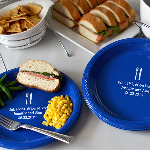 Blue dinner plate with white imprint personalized with design 2190 and 3 lines of text in Poised lettering style