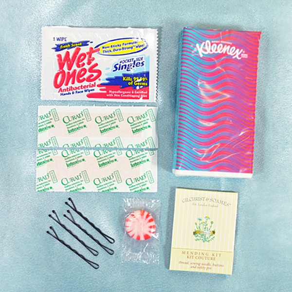 Survival kit includes band aids, bobby pins, towelette, sewing kit, breath mint and travel size Kleenex pack