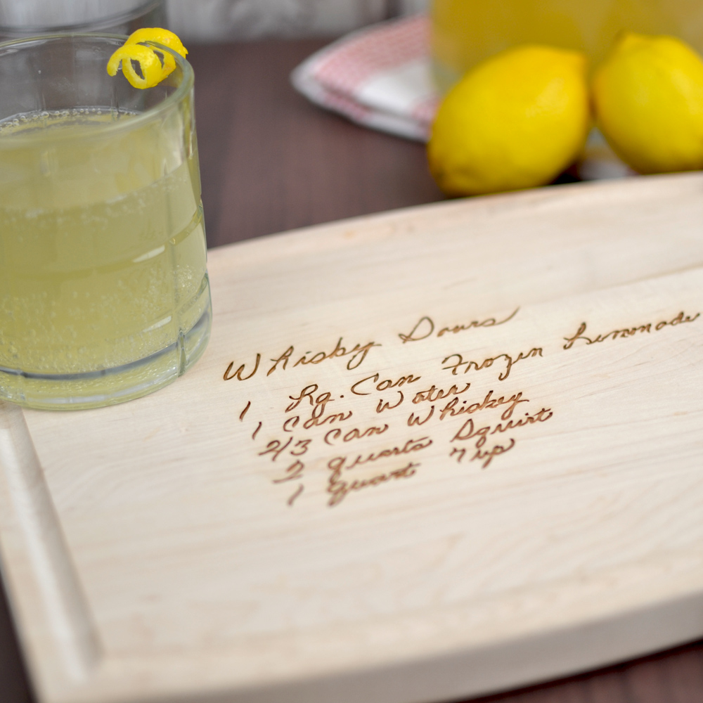 Closeup of personalized maple cutting board 9x12 size family recipe gift