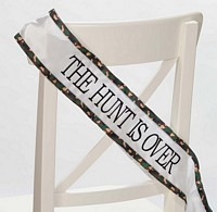 The Hunt Is Over green & brown camouflage bridal sash on chair back