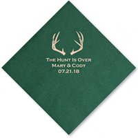 Luncheon napkin personalized with deer antlers design, 'the hunt is over' phrase, bride and groom's name and wedding date in ivory imprint color