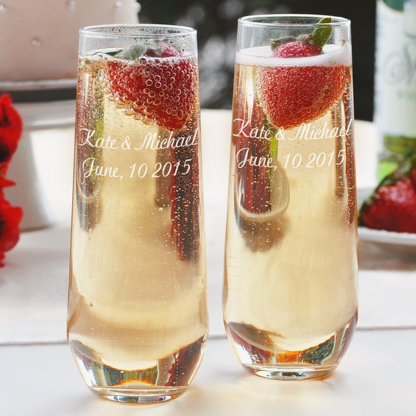 Stemless toasting flutes personalized with two lines of text in a script letter style