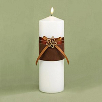 Ivory unity candle with brown ribbon wrap and rhinestone leaf