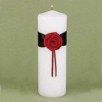 White unity candle with black satin ribbon and red rose bloom
