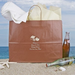 Large destination wedding gift bag custom printed with a seashell design and 4 lines of personal print from bride and groom